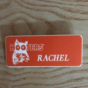 "Hooters Girl uniform name tag says ""Rachel"""